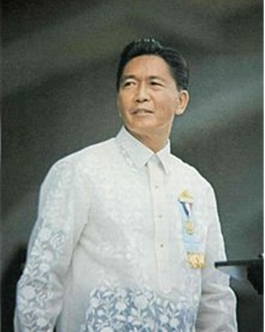 In this Photo, President Ferdinand Marcos is wearing a floral designed Barong Tagalog